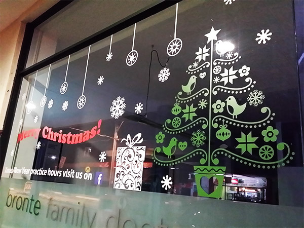Shop window christmas decal for a medical clinic at bronte sydney
